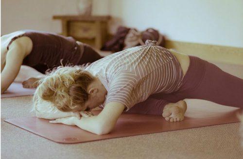 de 'Sleeping Swan' voor een goede stretch en het openen van de heupen